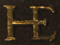 Micro 24. Detail of the monogram.