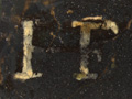 Micro 21. Detail of the monogram (25 x mag).
