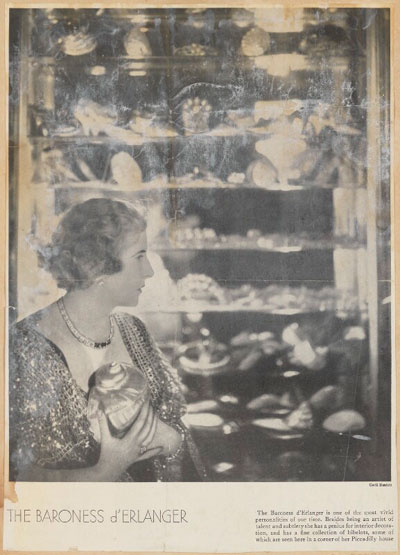 Fig. 1. Baroness Catherine d'Erlanger pictured with her cabinet of collected curiosities by Cecil Beaton, published 29th October 1930 © National Portrait Gallery (Ax135994)