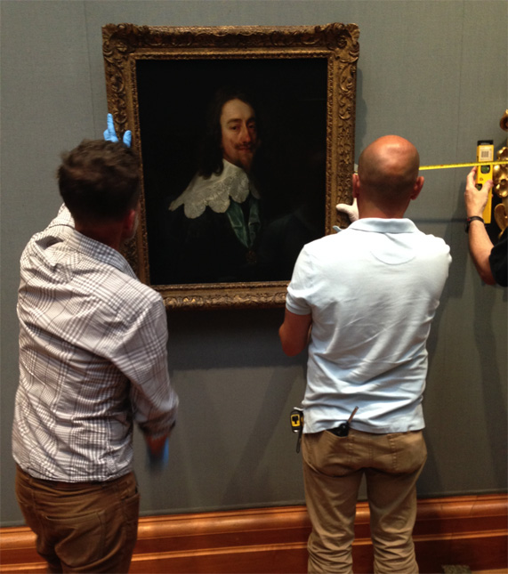 Here's a sneaky action shot of the Charles I being carefully hung on the wall for the display by three of the Gallery's art handlers.