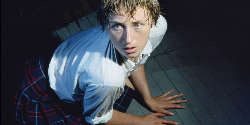 Cindy Sherman posing on floor