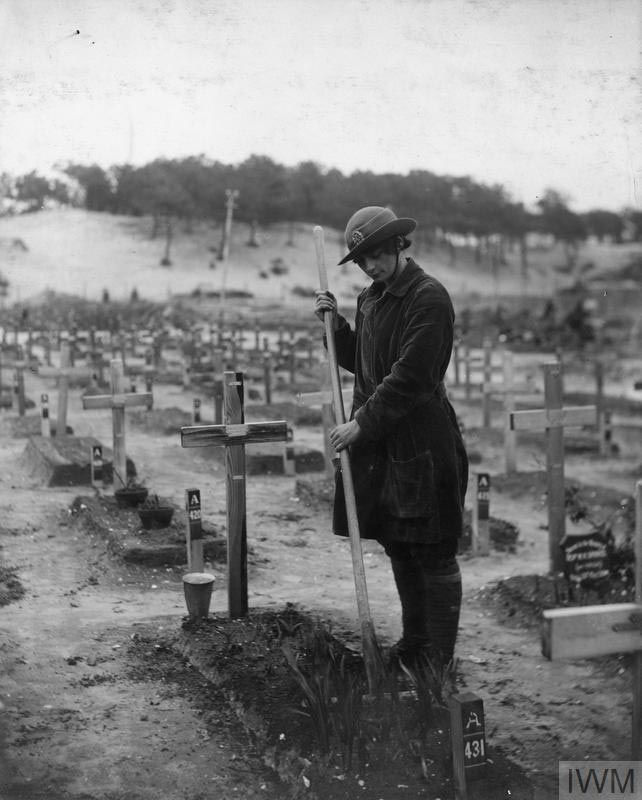 The grave of Betty Stevenson is tended to by a member of the Women's Army Auxiliary Corps (WAAC) in a graveyard at Etaples, France by Olive Edis, 1919 © Imperial War Museum (Q 8028) https://www.iwm.org.uk/collections/item/object/205214324