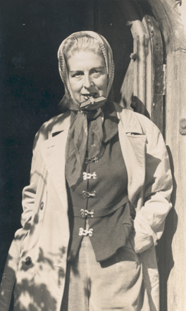 Self-portrait (with Nazi badge between her teeth) by Claude Cahun, 1945. Jersey Heritage Collections © Jersey Heritage