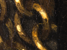 Photomicrograph of gold chain showing lead tin yellow highlights.