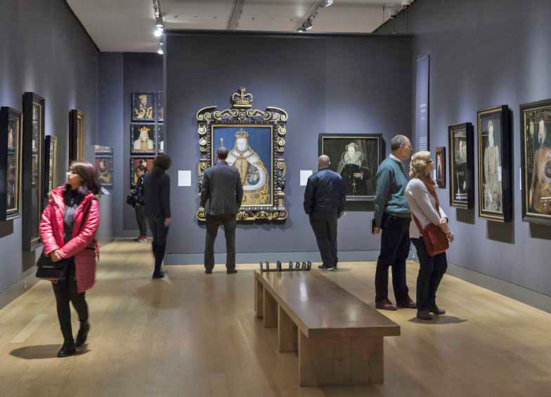 members, visitors viewing works of art in Tudor Gallery