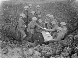 5.© IWM (Q 1429) Photograph by Lieutenant Ernest Brooks: Men of the Royal West Kent Regiment receive their pay from an officer in a shell hole near Mouquet Farm, October 1916
