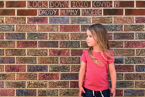 Watch the video, photograph of child by rainbow brick wall from Hold Still
