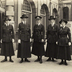Mary Sophia Allen (centre) with four members of her force  by Mrs Albert Broom (Christina Livingston) bromide print, 1916, NPG x6075 © National Portrait Gallery, London