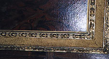 Detail of a carved and gilt reverse pattern frame