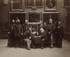 Sir George Scharf and the Staff of the National Portrait Gallery by an unknown photographer, probably 1885