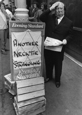 Alfred Hitchcock with news of another necktie strangling, London Evening Standard, July 1971 - © Getty Images