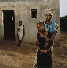 Joseline Ingabire with her daughter Leah Batamuliza, Rwanda from the series Intended Consequences: Mothers of Genocide, Children of Rape by Jonathan Torgovnik - © the artist