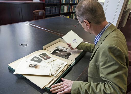 Visitor viewing works in Archive and library
