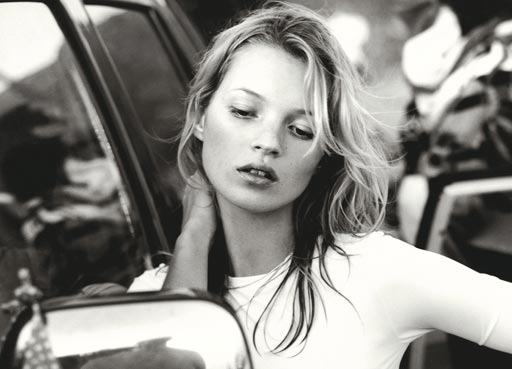 Room by room, photograph of Kate Moss, fashion model leaning on car